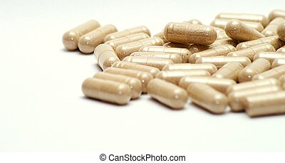 Brown pills - Closeup image of brown pills - roughage on the...