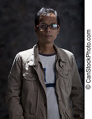 portrait of asian man forty three years old in studio light...