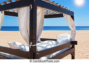 Lounger bed, on the beach for a relaxing getaway