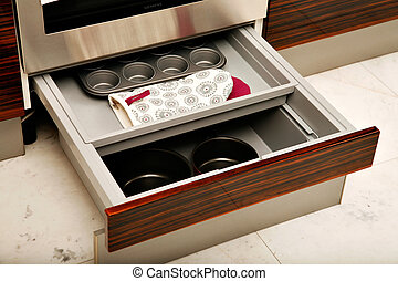 Kitchen drawers - A sliding kitchen drawer containing...