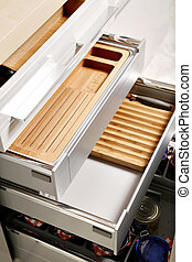 Modern kitchen drawers with compartments for various things