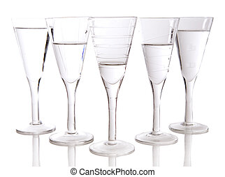 glasses - beautiful glasses filled with water on white...