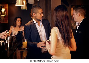 Young Businessman Hanging Out with Friends at the Bar -...