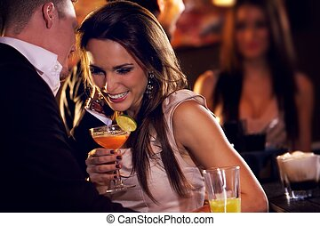 Happy Couple Enjoying the Party - Happy couple at the bar...