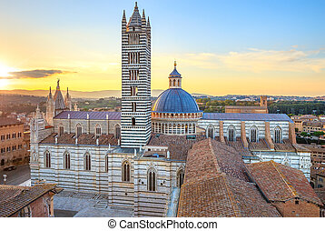 Siena aerial sunset panoramic view. Cathedral Duomo landmark. Tuscany, Italy.
