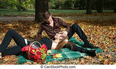 Teen couple at picnic in autumn - Happy young couple having...