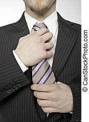 Tie Knot - businessman taking the tie knot on white...
