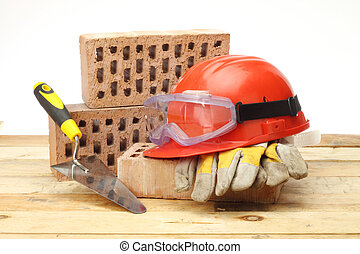 work place - Bricks, trowel and helmet on work place