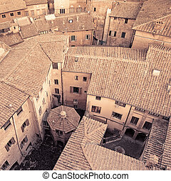 Aerial view background on italian medieval architecture roofs city building. Tuscany, Italy. Sepia toned.