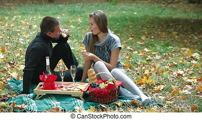 Teen couple at picnic in autumn park