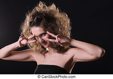 Vamp over dark - Vamp style young woman hands at face over...