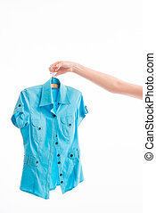 Woman chooses a blouse - Businesswoman chooses a new outfit