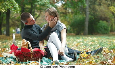 Couple enjoying a warm autumn day - Young loving couple...