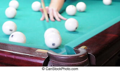 Playing pool, hitting the balls