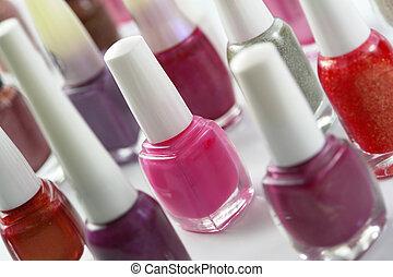 Nail Polish - Colorful nail polish bottles closeup