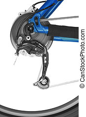 bicycle rear derailleur and wheel in motion over white...