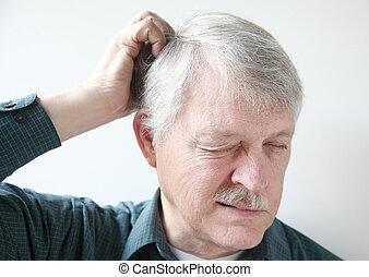 older man with dry scalp - senior man scratches his itchy...