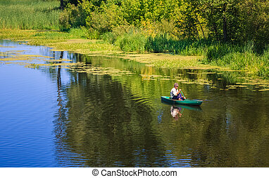 Old man fishing out of a row boat