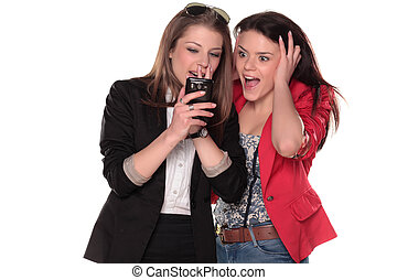 shocking message - two stunned teenagers read text messages...