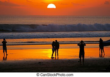 Admiring the sun - A beautiful sunset being admired by...
