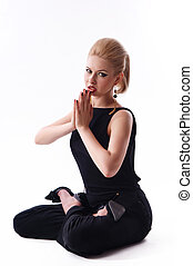 girl sitting in the lotus position