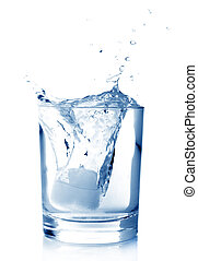 Ice in glass of water with splash on white background