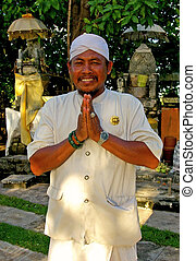 Balinese Greeting - A Balinese man wearing traditional...