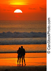 Romance in Bali - A couple admiring the sunset at Double Six...