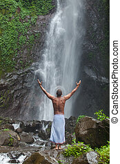 Handsome man at waterfall - Young handsome man enjoying...