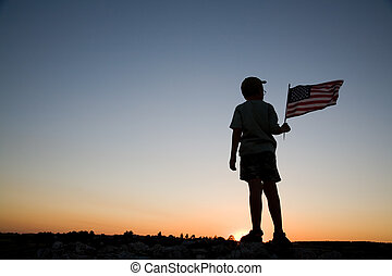Young boy with a flag. - Young boy holding an American flag...