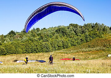 Paragliders are preparing to fly against the backdrop of the...