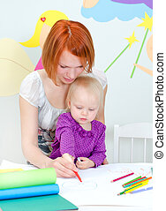 Mother and child drawing with color pencils