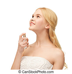 girl spraying perfume on her neck - picture of young girl...