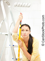 bored and tired young woman with paintroller - picture of...