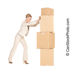 businesswoman moving big boxes - picture of attractive...