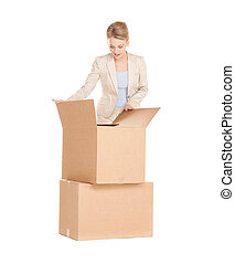 businesswoman unpacking big boxes - picture of attractive...