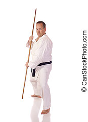 Man with a bo - Man in karate-gi with a bo staff in his...