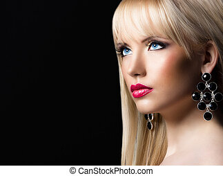 Portrait of young beautiful blonde woman with perfect makeup...