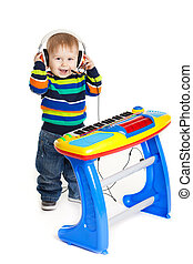 little boy and the keyboard on white background funny boy...