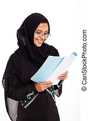 female Muslim woman reading book