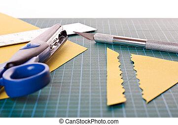 Scrapbooking material: ruler, scissors, mat and knife