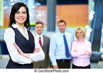 Business woman and a group of workers. - Group of business...