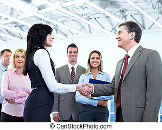 Business meeting - Group of business people in a modern hall...