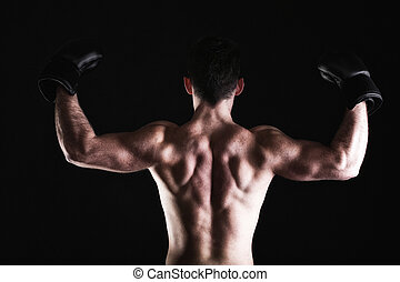 strong athletic muscle man sports guy showing his muscles -...