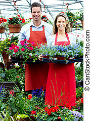 People working in nursery Gardening background