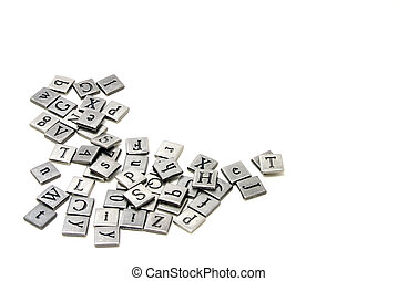 Metal scrapbooking letters laying on a white background