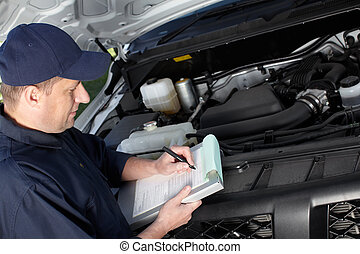 Car mechanic working in auto repair service - Professional...