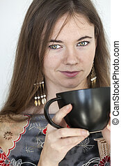 Young Woman with Beautiful Green Eyes with Black Coffee Cup...