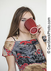 Young Woman with Beautiful Green Eyes with Red Coffee Cup