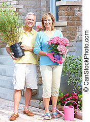 Gardening couple - Happy senior couple in the garden...